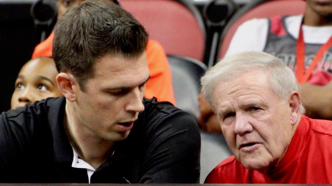 Louisville acting coach David Padgett talks with former Cardinals coach Denny Crum during a team scrimmage Friday night. (WDRB photo by Eric Crawford)