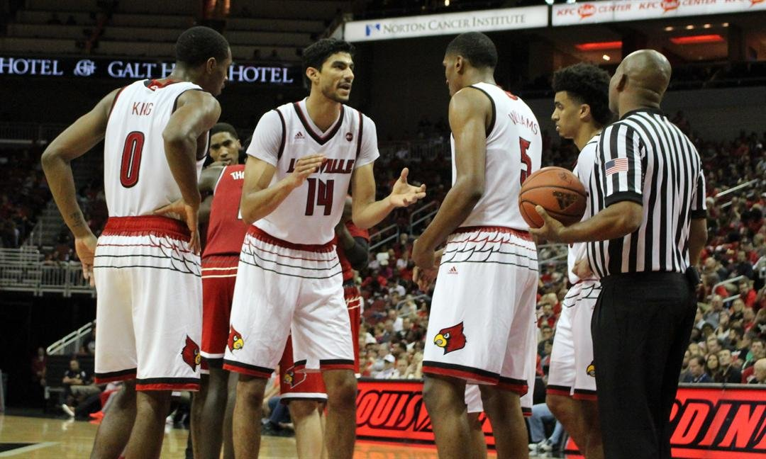 Anas Mahmoud rallies teammates during the Red-White scrimmage. (WDRB photo by Eric Crawford)