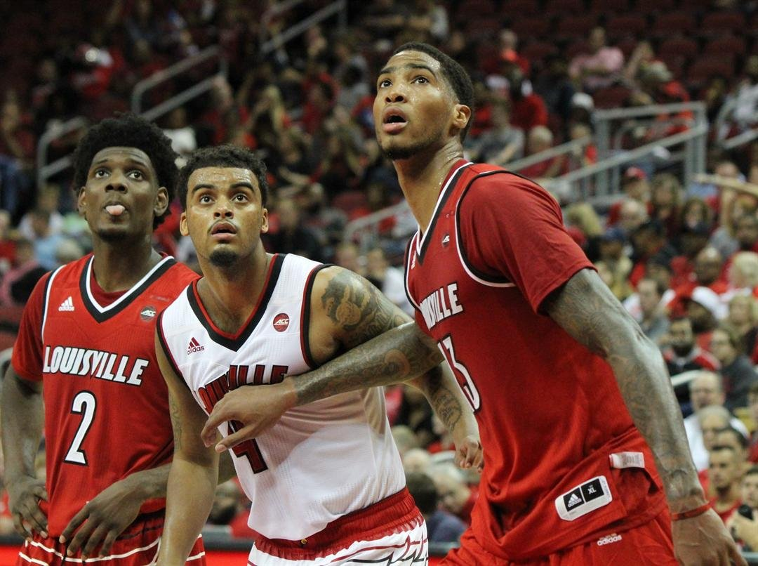 Ray Spalding, Quentin Snider and Darius Perry wait for a rebound after a free-throw in Friday's Red-White game (WDRB photo by Eric Crawford)