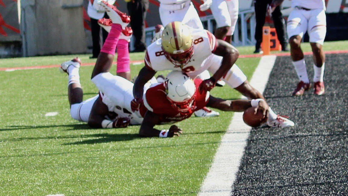 Lamar Jackson stretches for a first-half touchdown in Louisville's loss to Boston College on Saturday. (WDRB photo by Eric Crawford)