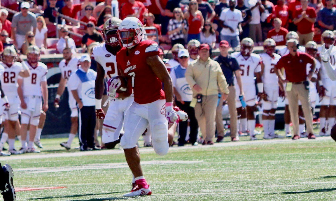 Reggie Bonnafon breaks free for a second quarter touchdown run. (WDRB photo by Eric Crawford)