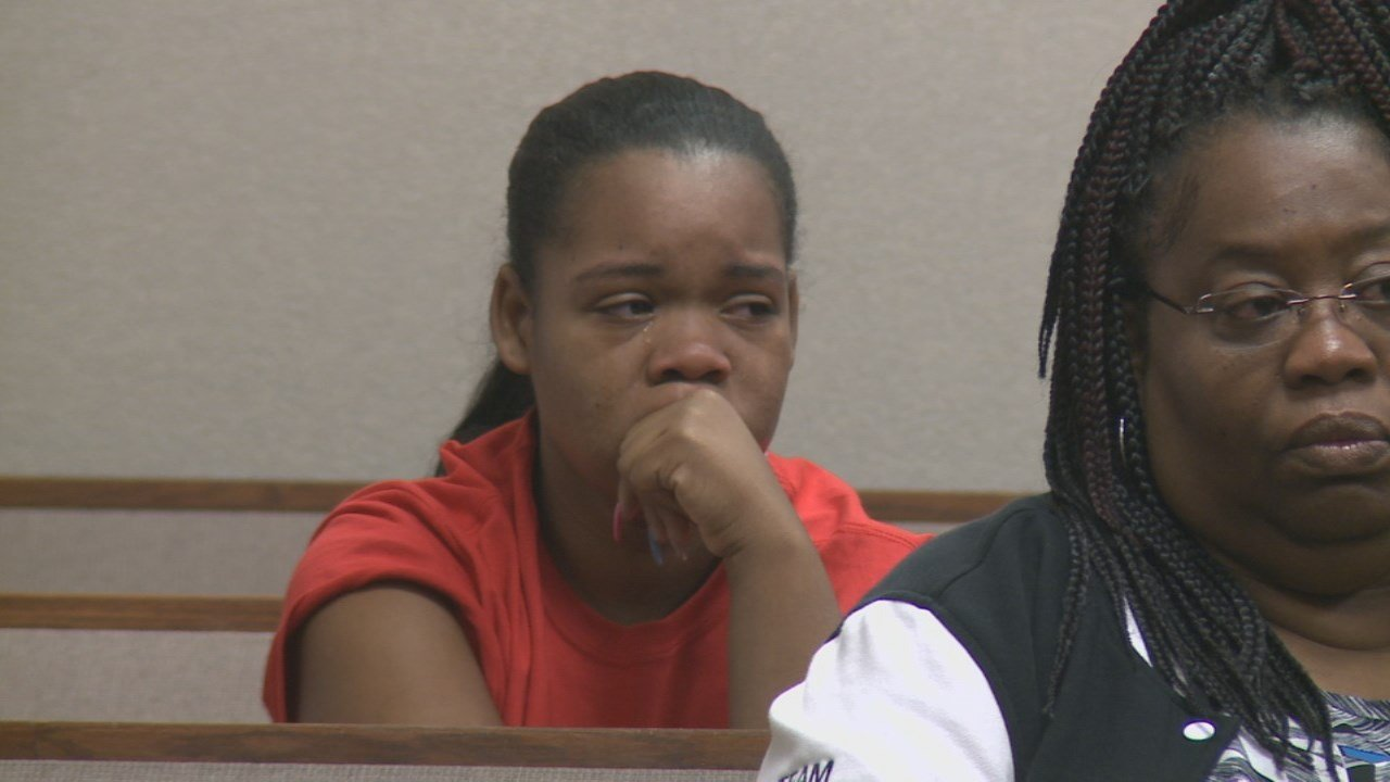 Micheshia Norment, Hobbs' mother, weeps in court when she sees her son's accused killer for the first time.