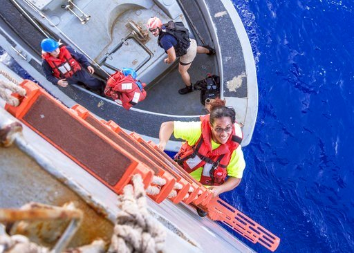 (Mass Communication Specialist Class Jonathan Clay/U.S. Navy via AP). In this Wednesday, Oct. 25, 2017 photo, Tasha Fuiaba, an American mariner who had been sailing for five months on a damaged sailboat, climbs the ladder to board a Navy ship.