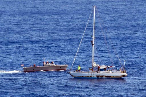 (Mass Communication Specialist 3rd Class Jonathan Clay/U.S. Navy via AP). In this Wednesday, Oct. 25, 2017 photo, sailors from the USS Ashland approach a sailboat with two Honolulu women and their dogs aboard as they are rescued after being lost at sea.