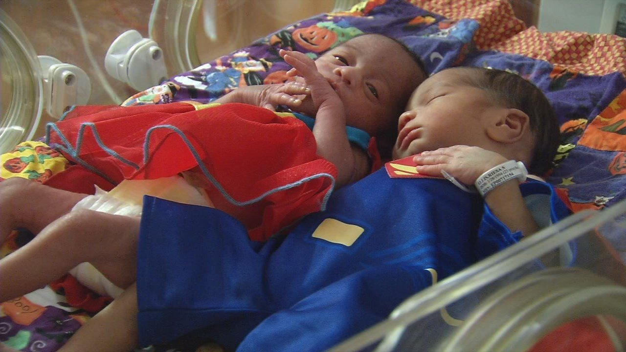 NICU babies dressed in Halloween costumes knitted by their nurse