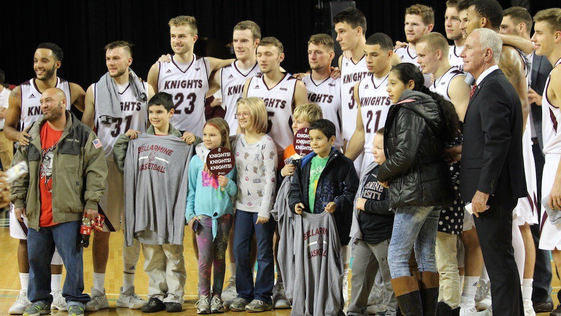 Bellarmine's coaches and players pose with patients from the Norton Children's Hospital oncology unit. (WDRB photo by Eric Crawford)