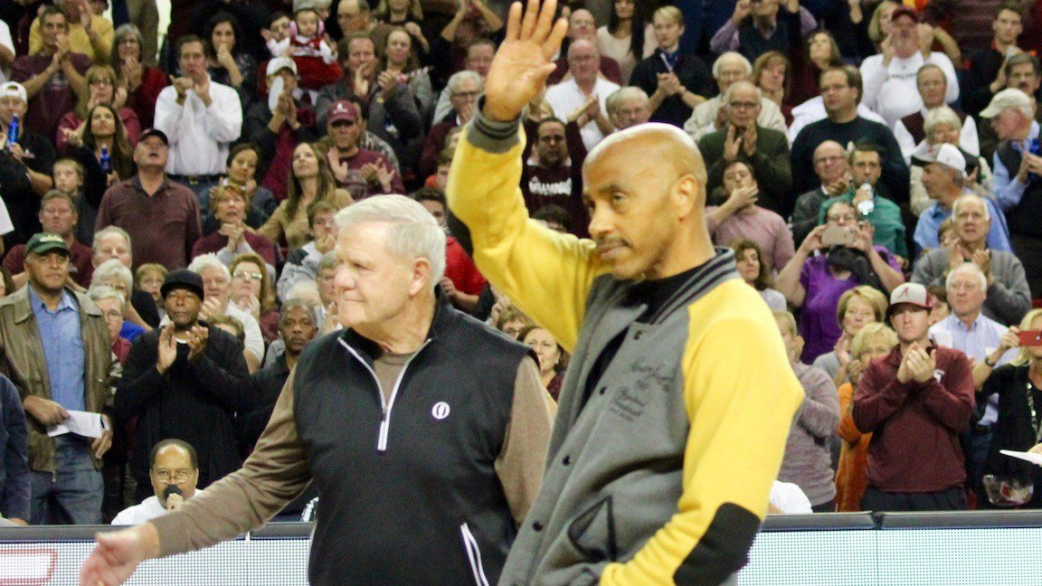 Hall of fame coach Denny Crum and Darrell Griffith wave to the crowd at Freedom Hall. (WDRB photo by Eric Crawford)