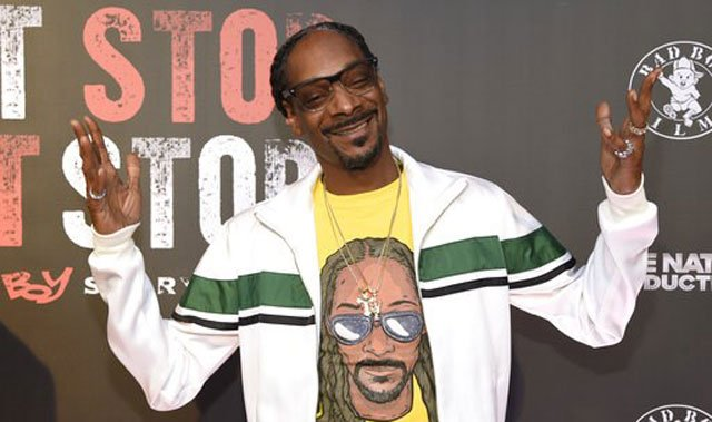 "(Photo by Chris Pizzello/Invision/AP, File). FILE - In this Wednesday, June 21, 2017, file photo, Snoop Dogg arrives at the Los Angeles premiere of ""Can't Stop, Won't Stop: A Bad Boy Story"" at the Writers Guild Theater on in Beverly Hills, Calif."