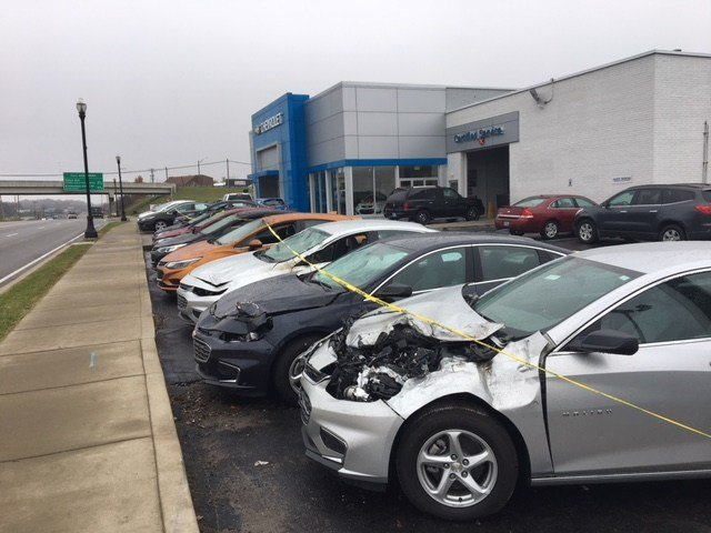 A row of cars was heavily damaged when a man lost control of his vehicle and rolled over top of the cars at the Big M Chevy dealership in Radcliff, Ky. on Nov. 1, 2017.