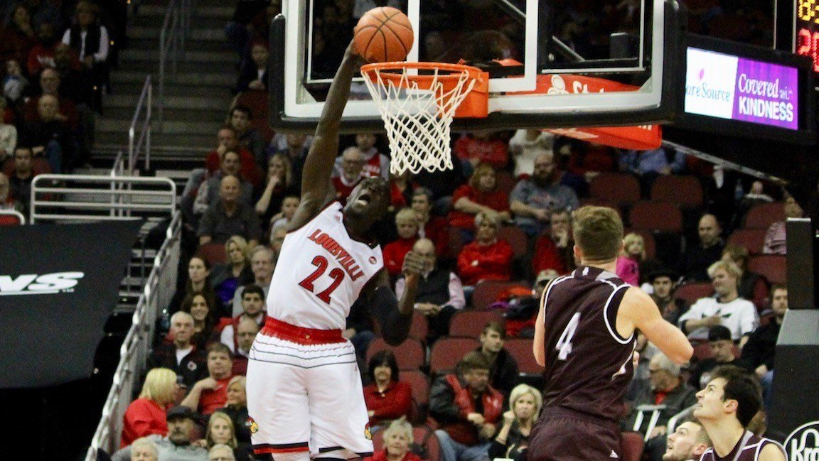 Deng Adel finishes a slam against Bellarmine (WDRB photo by Eric Crawford)