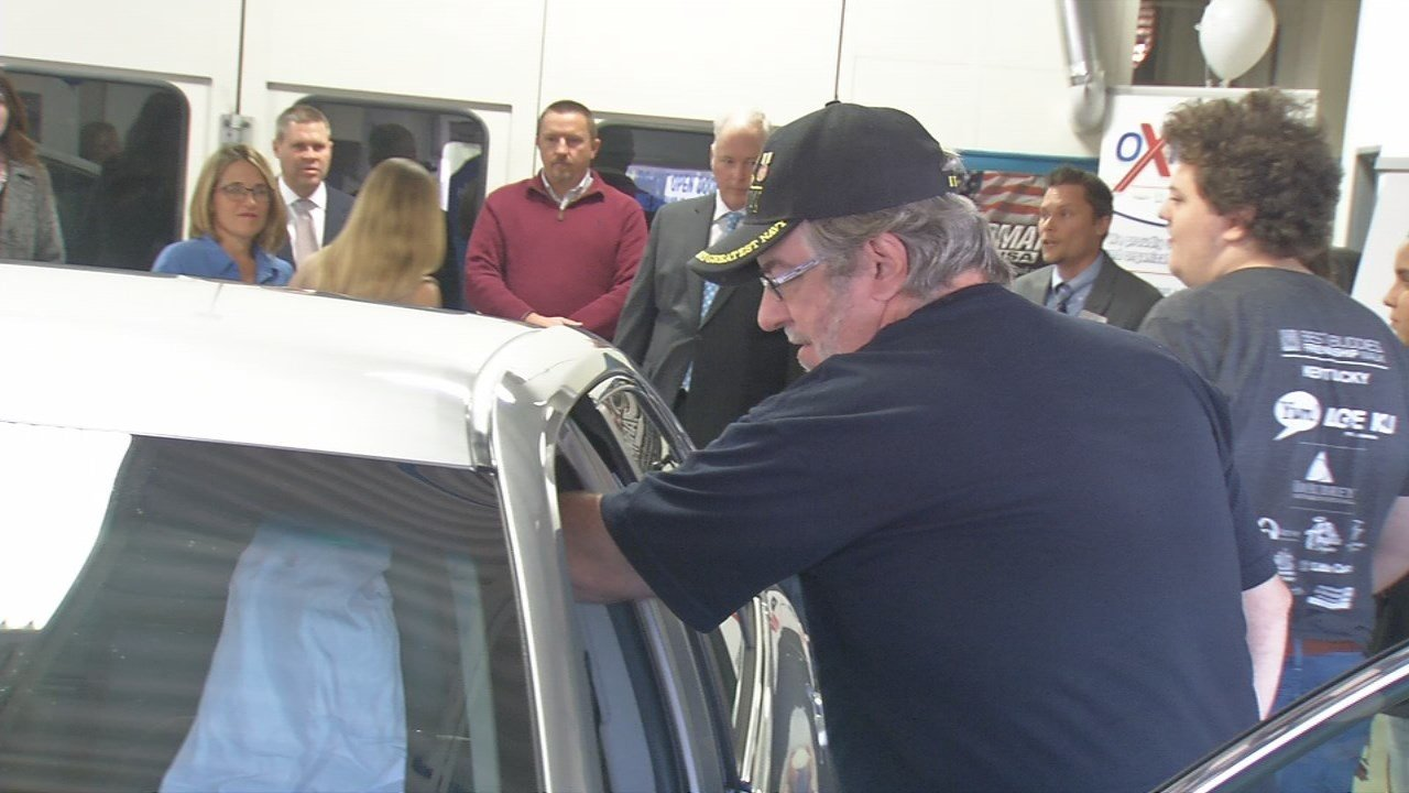 Navy vet Brian Malone checks out the Toyota Camry donated to his family by the Oxmoor Auto Group.