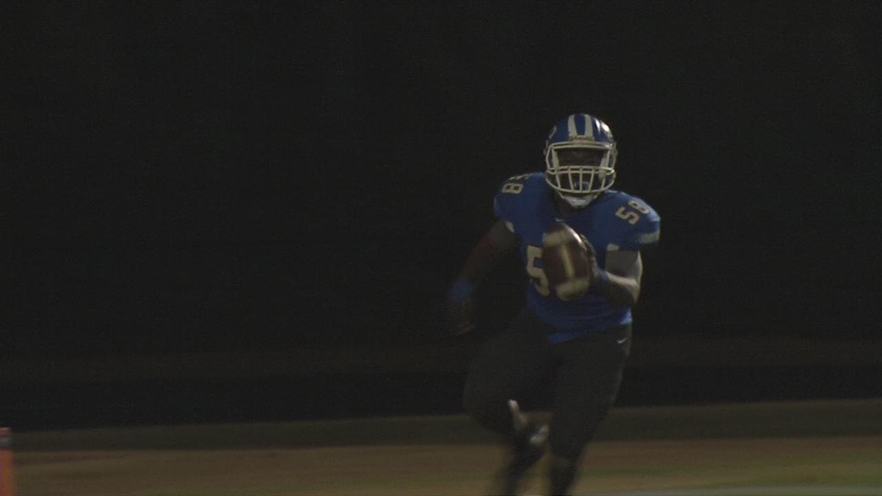 Kentucky Country Day's Chris Scott recovers a bobbled snap and runs it in for a touchdown.