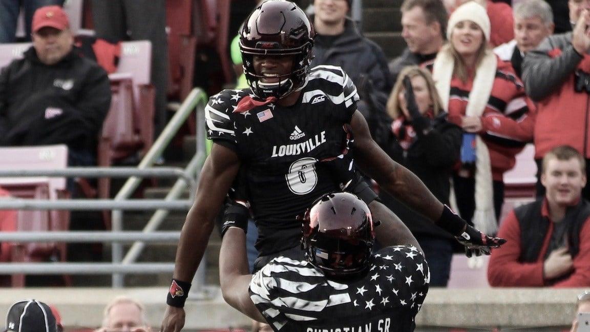 Lamar Jackson celebrates a 68-yard touchdown run against Virginia (WDRB photo by Eric Crawford)