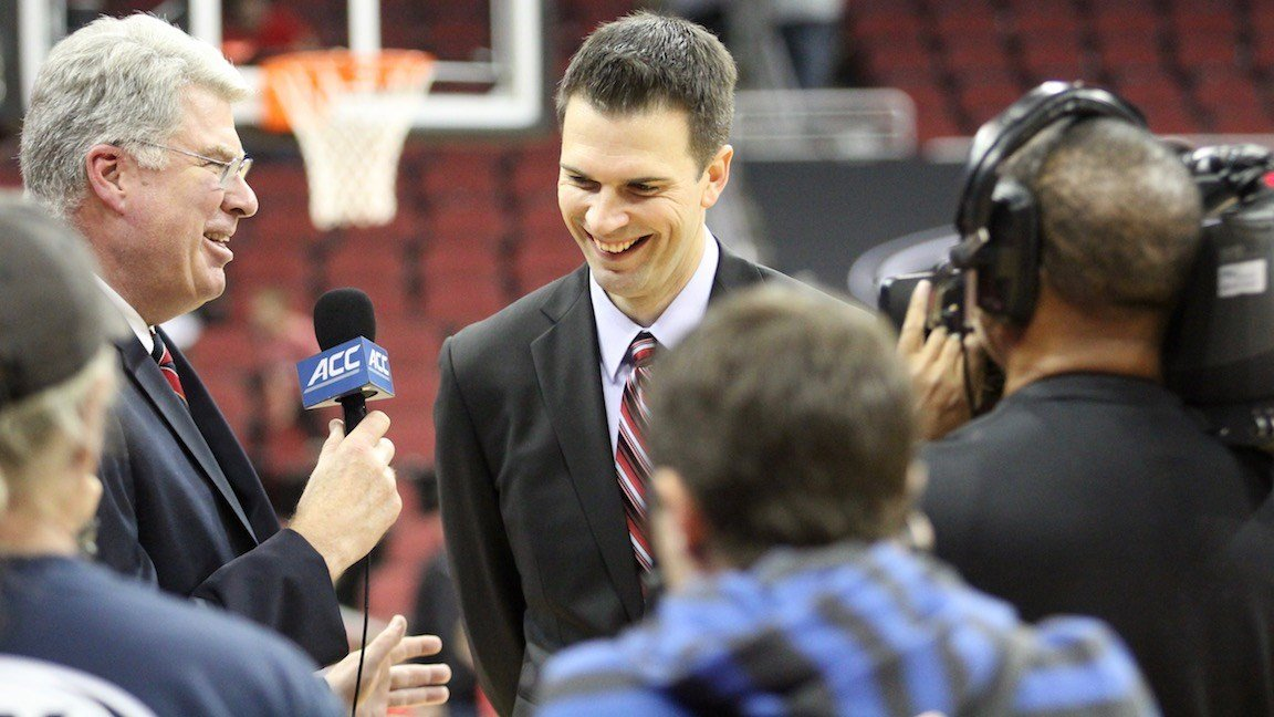 David Padgett was interviewed by Mike Gminski after winning his first game as Louisville's interim basketball coach Sunday. (Eric Crawford photo)