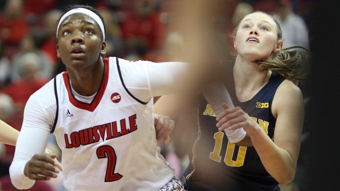 Myisha Hines-Allen battles Michigan's Nicole Munger for a rebound. (WDRB photo by Eric Crawford)