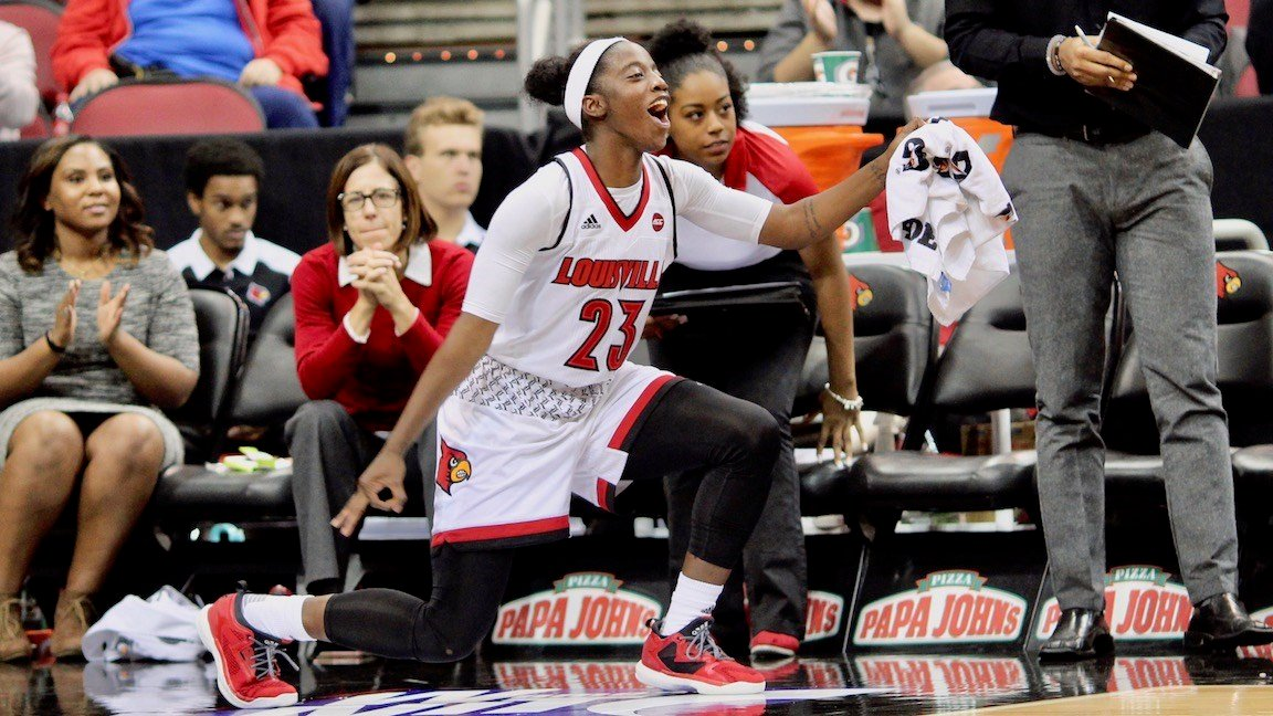 Sophomore Jazmine Jones celebrates late in Louisville's blowout win over Michigan. (WDRB photo by Eric Crawford)
