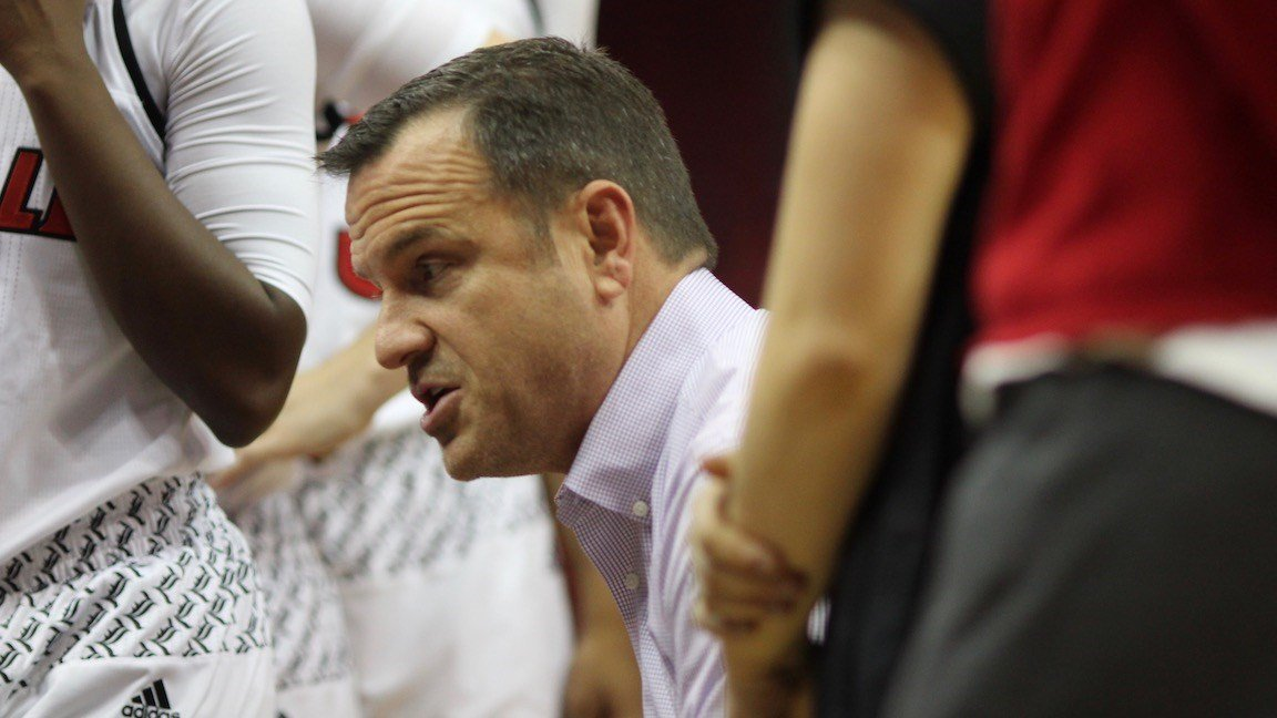 Jeff Walz talks to his team in the first half of Thursday's win over Michigan. (WDRB photo by Eric Crawford)
