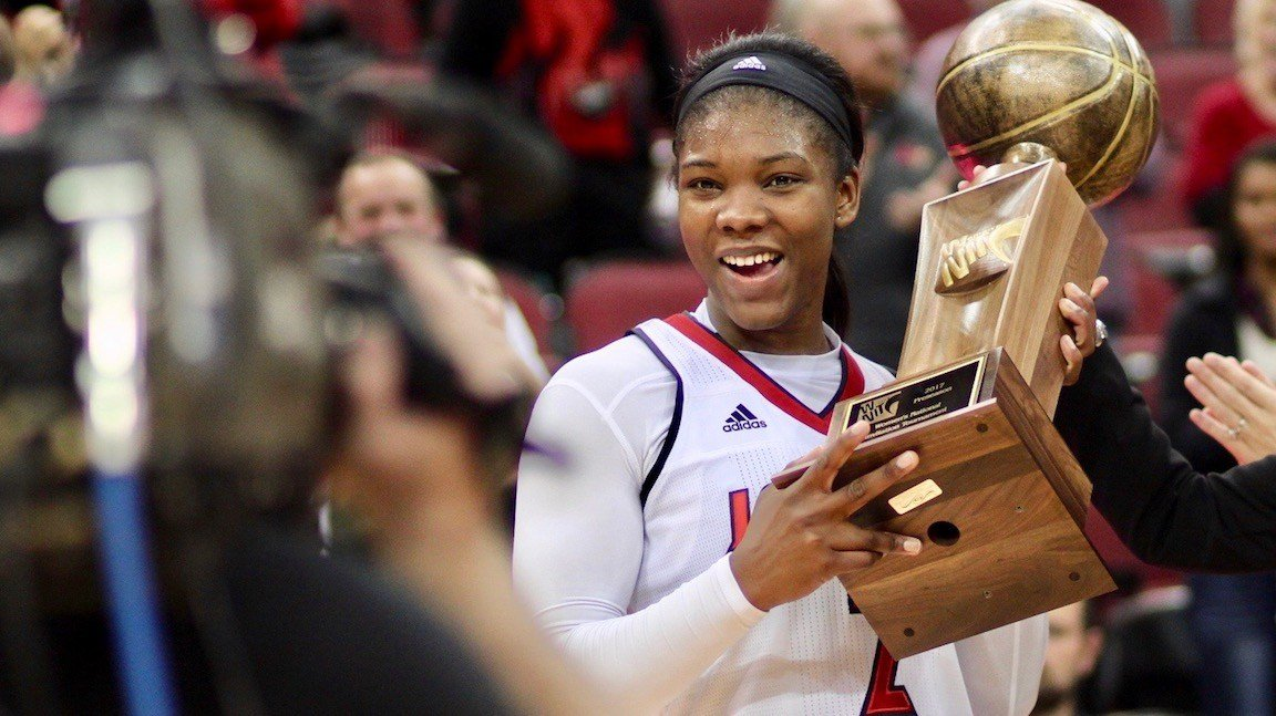 Senior Myisha Hines-Allen poses with the WNIT trophy after being named the event's MVP. (WDRB photo by Eric Crawford)