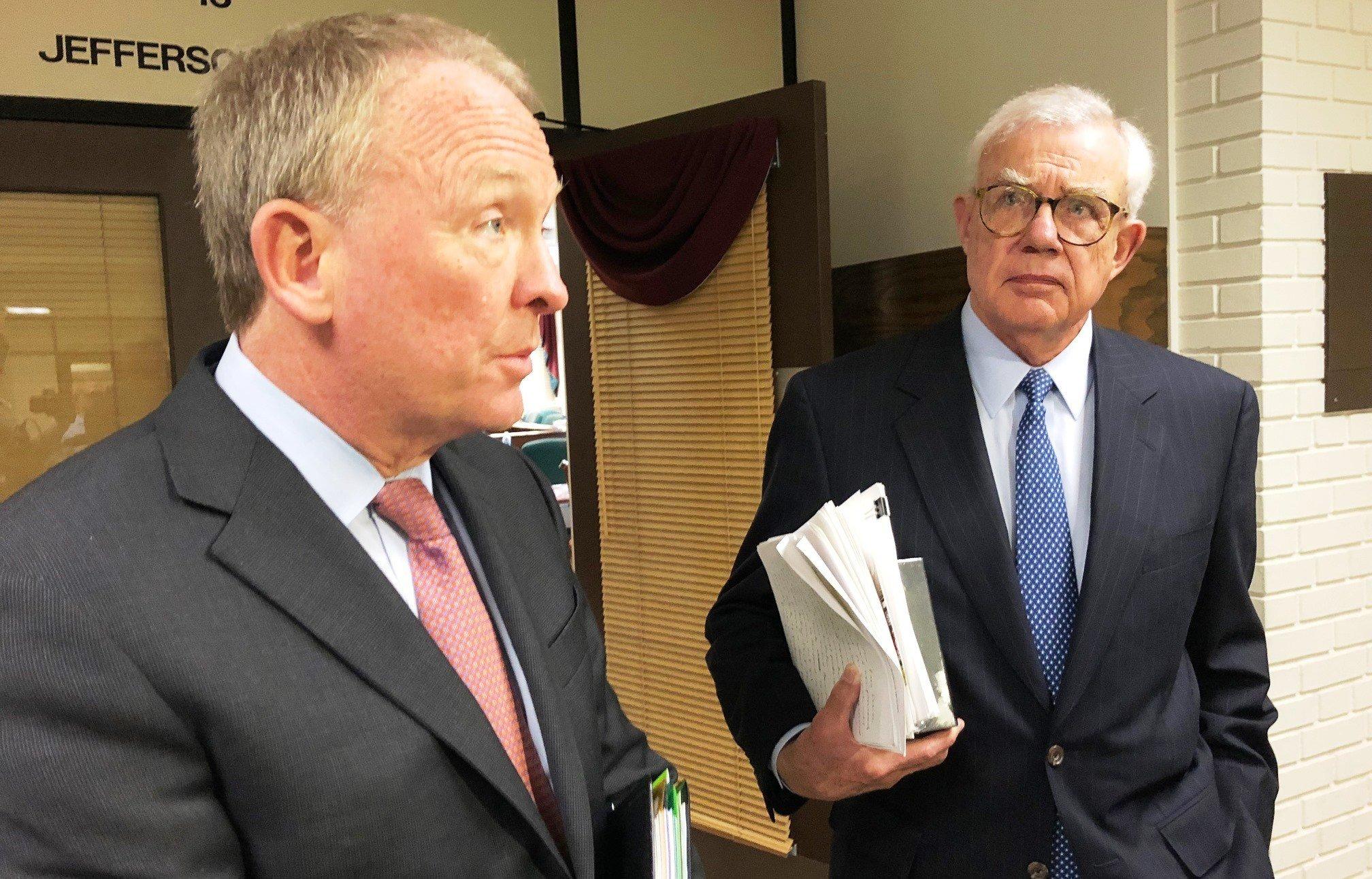 U of L trustees chairman David Grissom, right, and interim President Greg Postel. Nov. 20, 2017