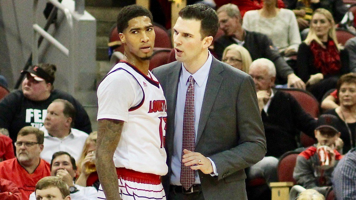 David Padgett speaks with Ray Spalding, who finished with 19 points, 13 rebounds and five blocks. (WDRB photo by Eric Crawford)