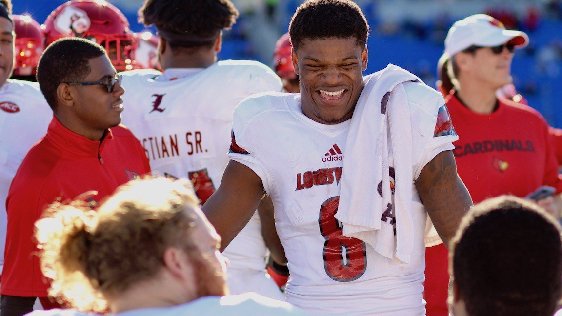 Lamar Jackson smiles with teammates after being pulled from Louisville's runaway win over Kentucky Saturday. (WDRB photo by Eric Crawford)