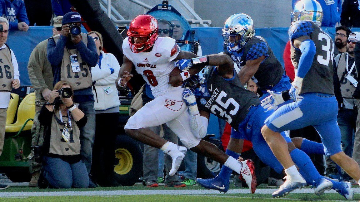 Lamar Jackson pulls away from Kentucky defenders during a second-half run. (WDRB photo by Eric Crawford)
