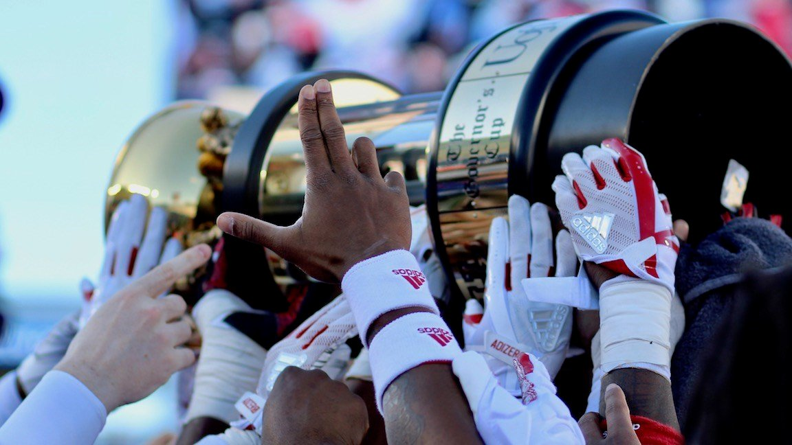 Louisville players hoist the Governor's Cup trophy. (WDRB photo by Eric Crawford)