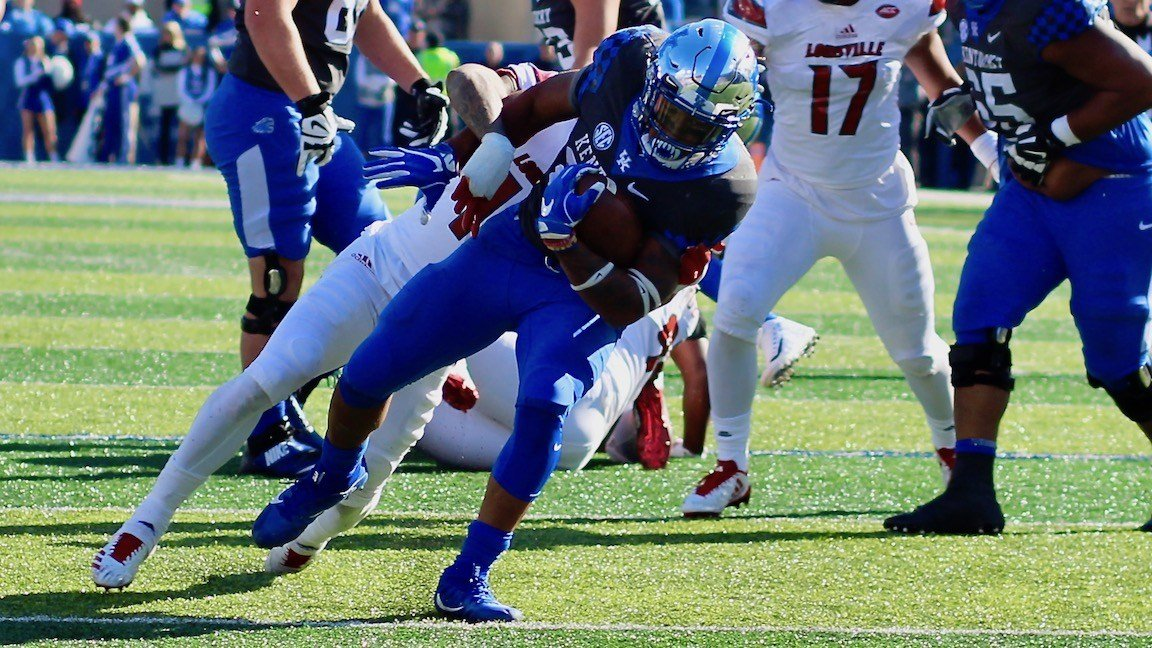 A familiar sight Saturday: Kentucky's Benny Snell carrying a defender. (WDRB photo by Eric Crawford)