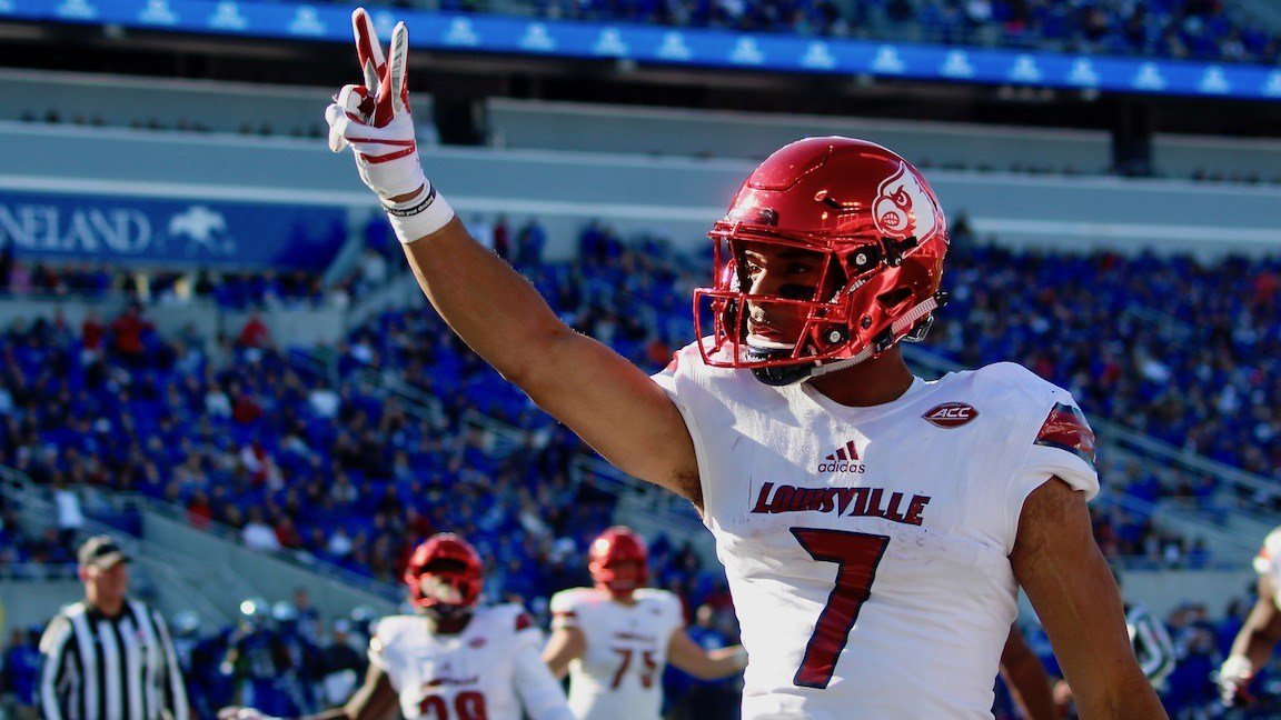 Louisville's Reggie Bonnafon lets Kentucky fans know how many TDs he has scored. (WDRB photo by Eric Crawford)