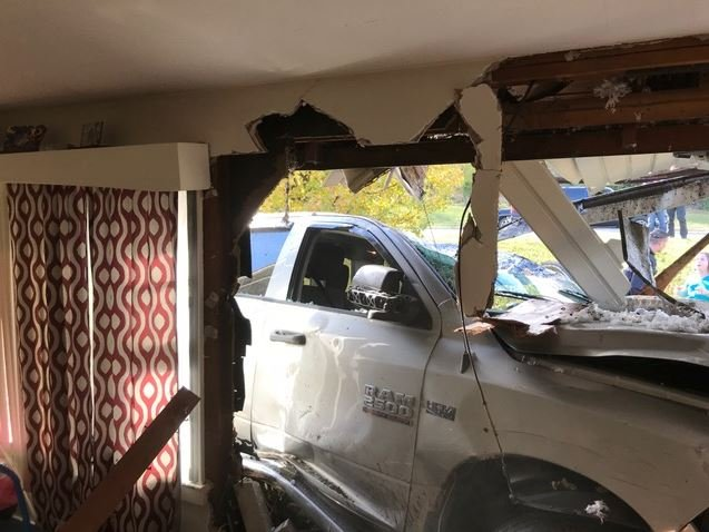 Truck driven by 11-year-old with medical condition crashes into home