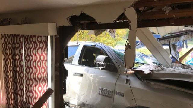 Girl, 10, crashes a pick-up truck into a house 'on purpose'