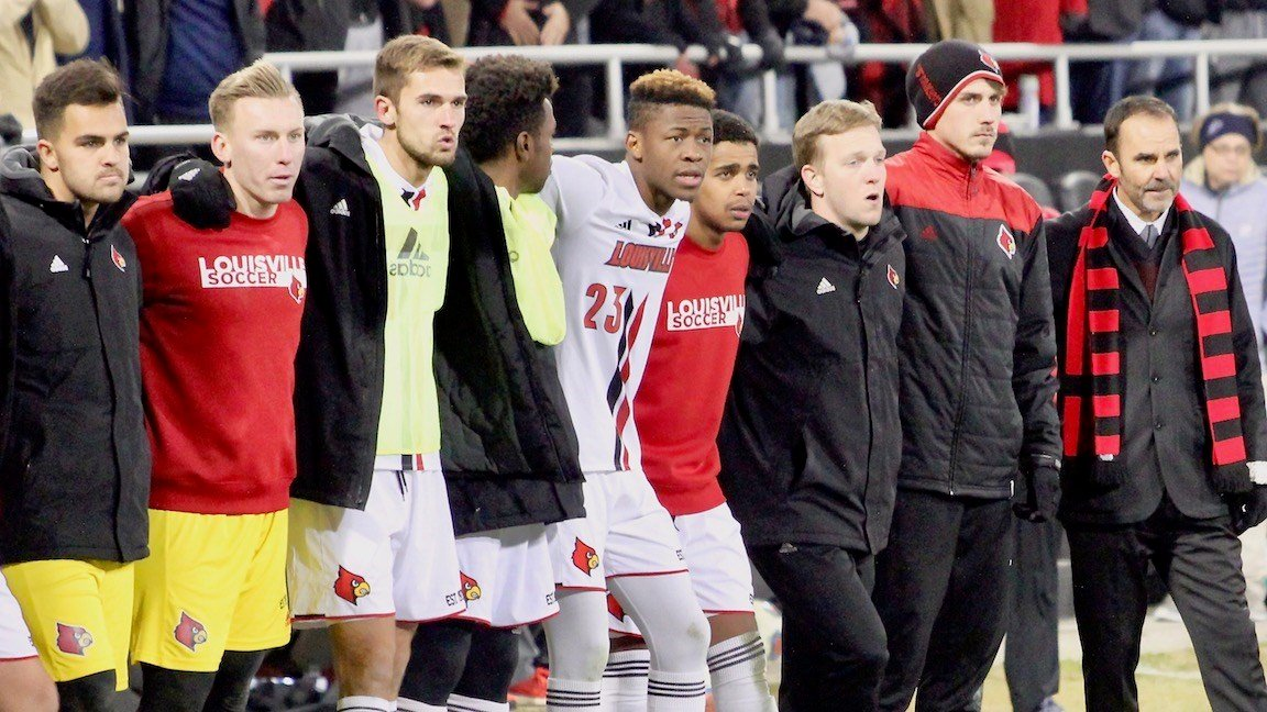 Louisville coach Ken Lolla and his players watch before the final penalty kick is taken. (WDRB photo by Eric Crawford)