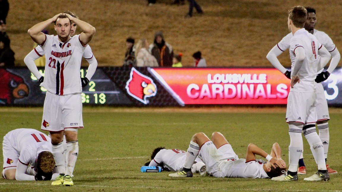 Louisville players react after the loss. (WDRB photo by Eric Crawford)
