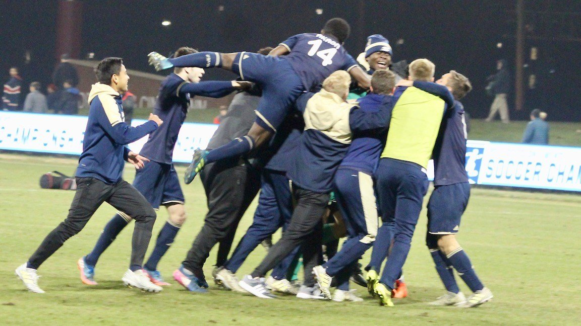 Akron celebrates after its win at Louisville (WDRB photo by Eric Crawford)