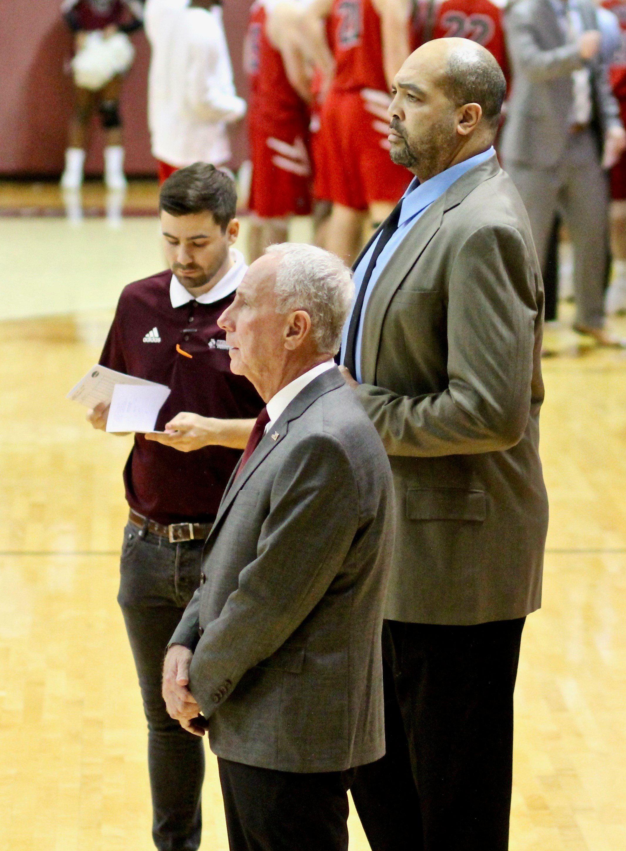 Former Louisville and NbA center Felton Spencer watches Bellarmine warmups with head coach Scott Davenport (WDRB photo by Eric Crawford)