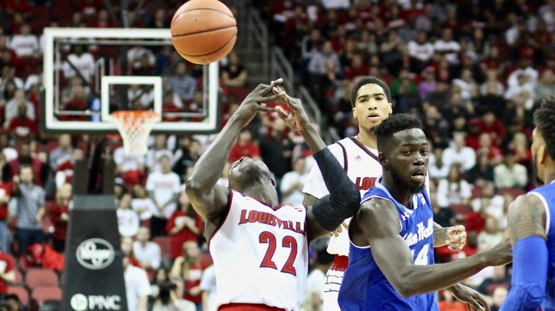 Deng Adel loses the ball in traffic in Louisville's loss to Seton Hall on Sunday. (WDRB photo by Eric Crawford)