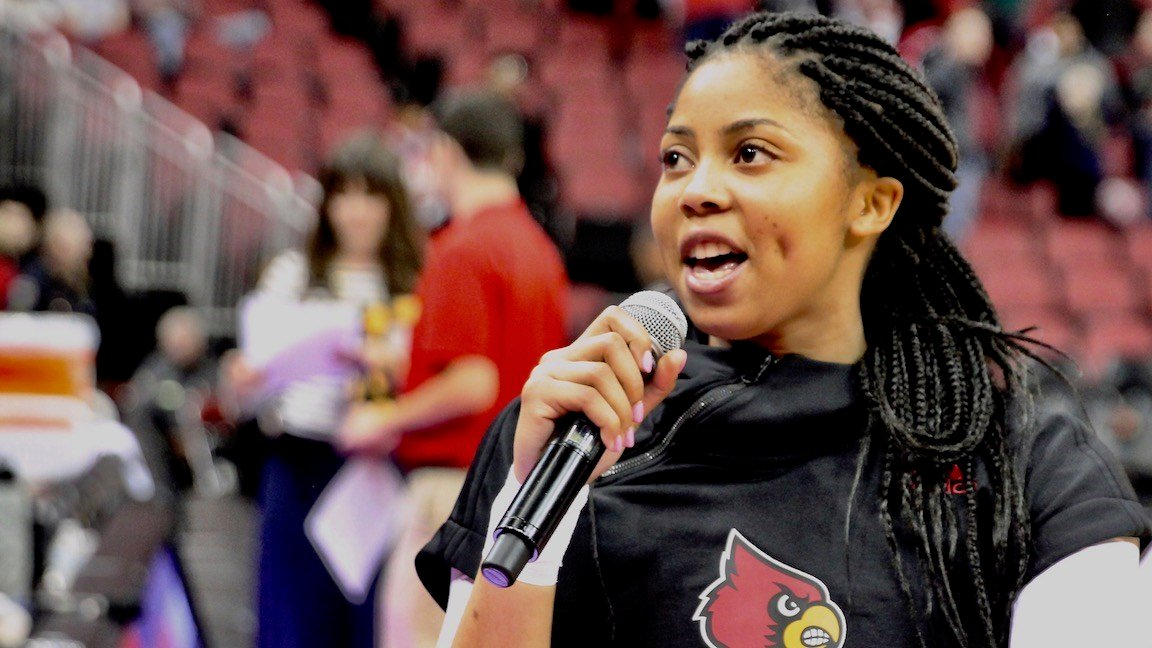 Junior point guard Arica Carter talks to the crowd after Tuesday's win. (WDRB photo by Eric Crawford)