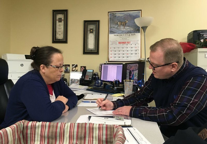 (PHOTO SOURCE: AP) Rowan County Clerk Kim Davis sits across from David Ernold, who was denied a marriage license in 2015.