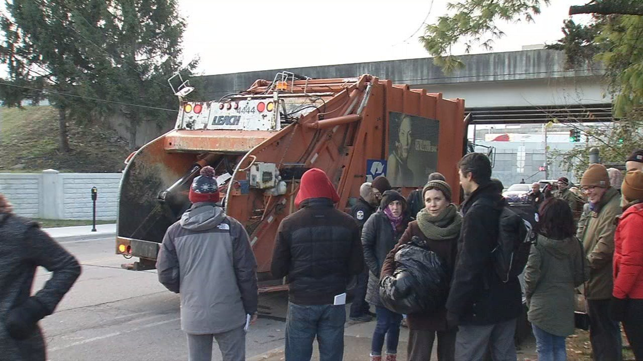A garbage truck was loaded with trash and unclaimed belongings taken from a homeless camp cleared out near downtown Louisville.