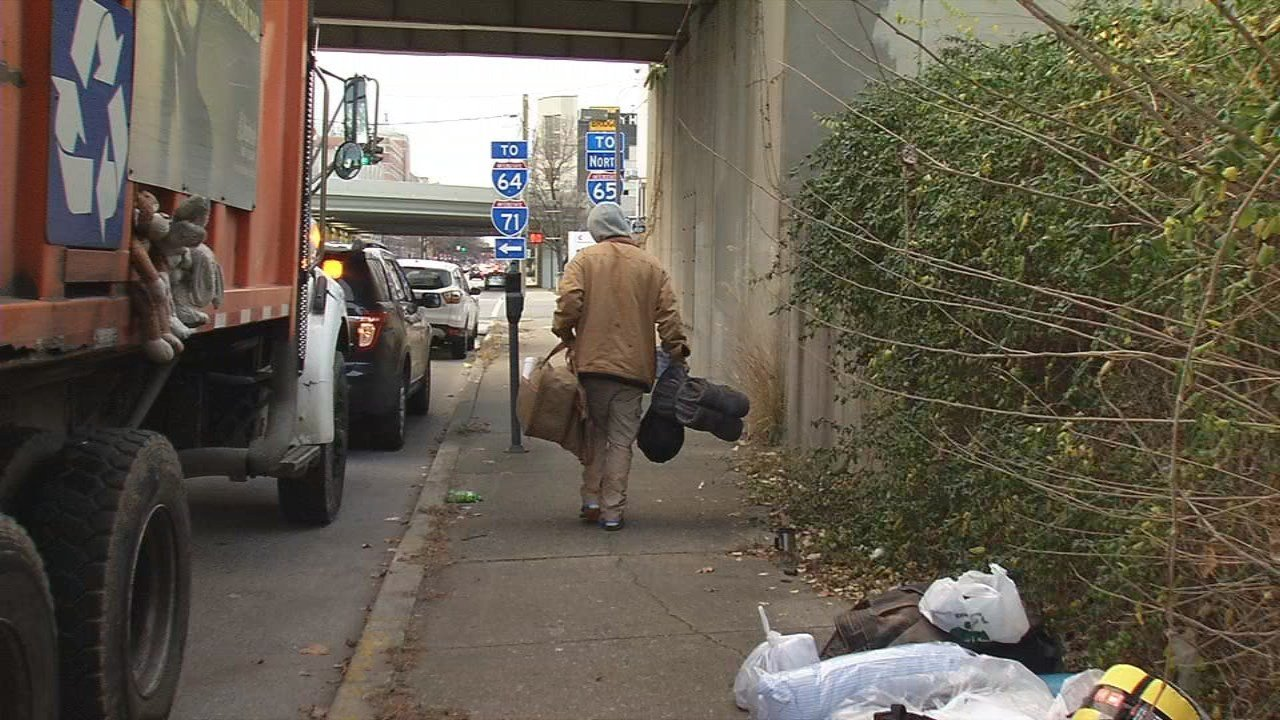 Daniel McStoots walks away from an overpass where has been living since August after the city ordered everyone out. He says he doesn't know where he'll end up.
