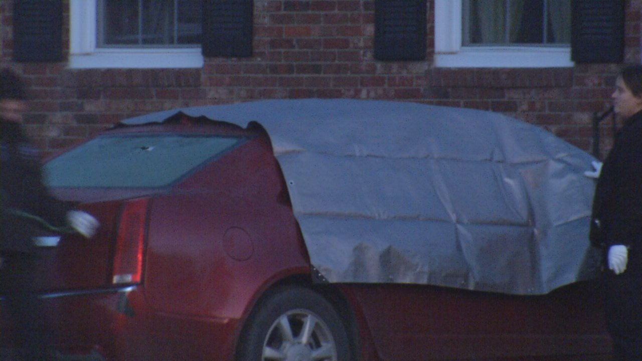 At least one apparent bullet hole was visible in the back windshield of a car where a man's body was found early on Dec. 8, 2018.
