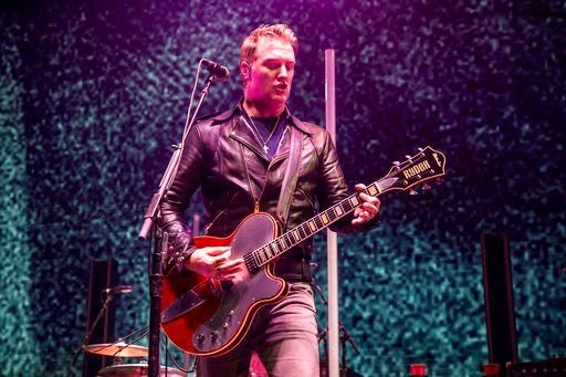 Josh Homme caught on video kicking photographer at concert