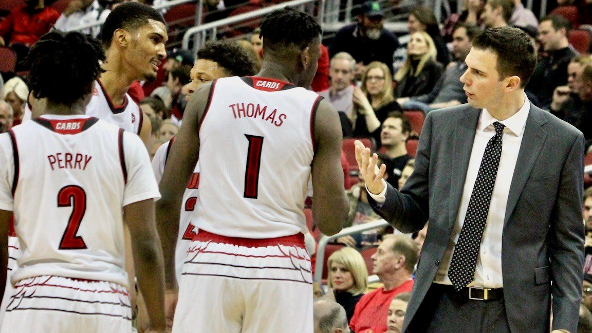 Louisville coach David Padgett talks to three of his freshmen during Monday's win over Bryant. (WDRB photo by Eric Crawford)