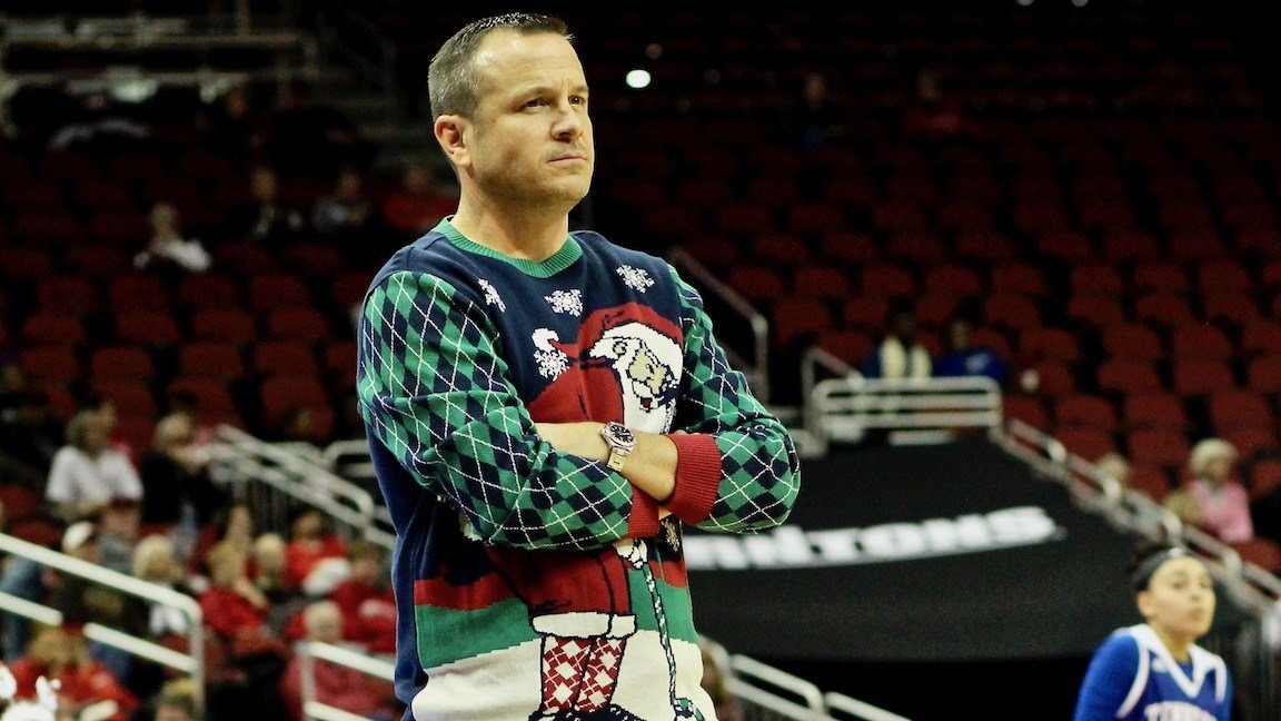Jeff Walz and his staff got into the spirit of the season with Christmas sweaters at Tuesday's game. (WDRB photo by Eric Crawford)