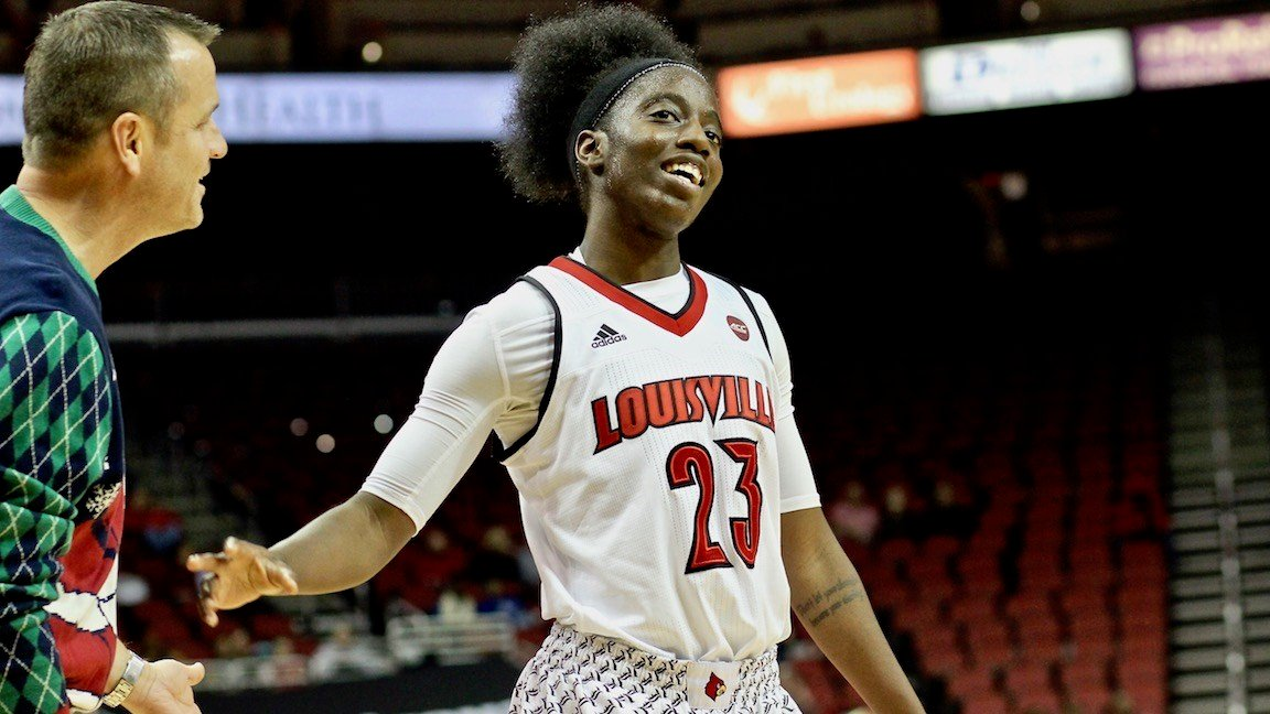 Jeff Walz lets Jazimne Jones know she made a great save on a ball that was going to be Louisville's possession anyway. (WDRB photo by Eric Crawford)
