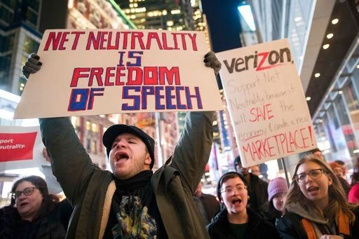 (AP Photo/Mary Altaffer, File). FILE - In this Thursday, Dec. 7, 2017, file photo, demonstrators rally in support of net neutrality outside a Verizon store in New York.