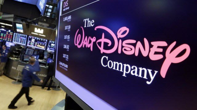 AP PHOTO/Richard Drew) - In this Aug. 8, 2017 file photo the Walt Disney Co. logo appears on a screen above the New York Stock Exchange.