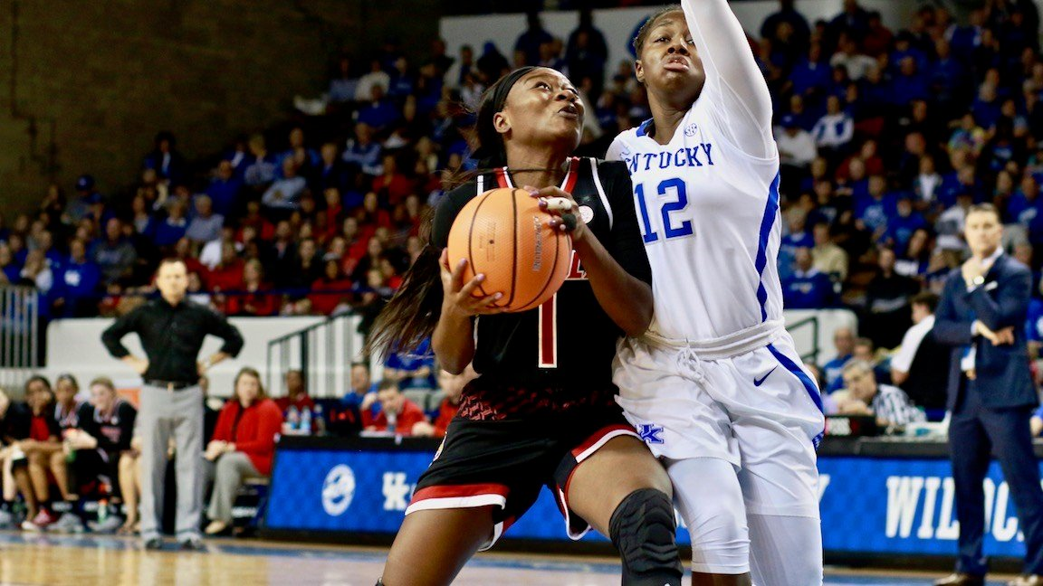 Louisville's Dana Evans drives on Amanda Paschal in Sunday's victory. (WDRB photo by Eric Crawford)