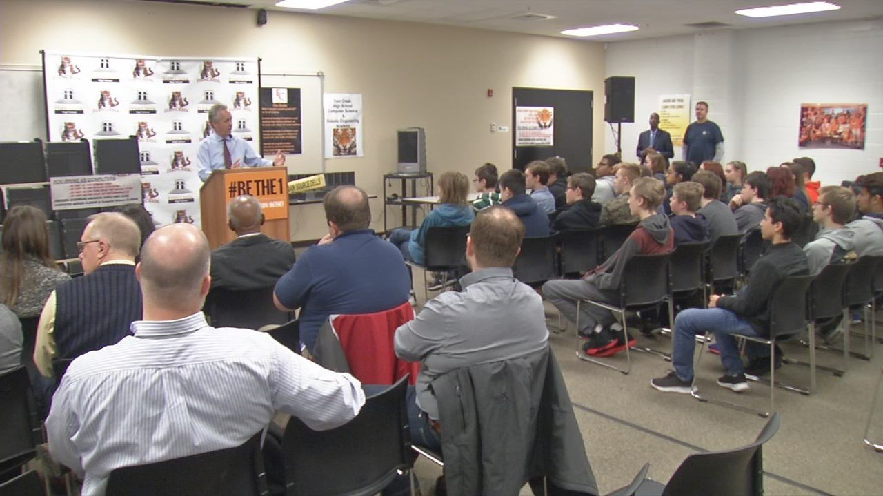 Louisville Mayor Greg Fischer thanked students at Fern Creek High School for refurbishing dozens of computers for public housing residents and refugees.
