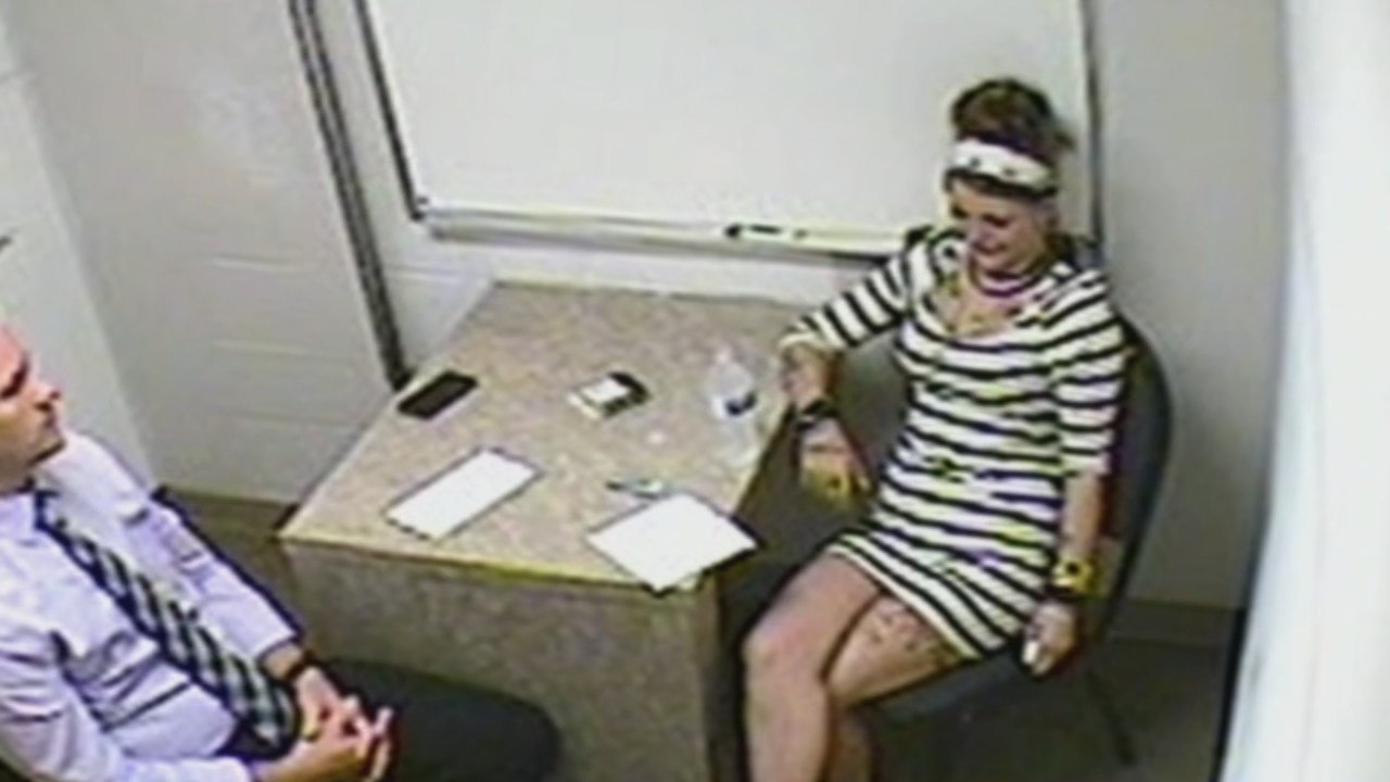 Monica Mudd being questioned by authorities.